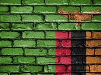 Sambian pihaleikit: Tiiliseinään maalattu lippu